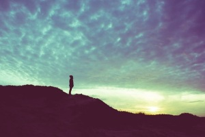 Graphicstock back light silhouette of a man standing on a hill overlooking filtered vintage future power achievement concept B6d55RJ5kZ