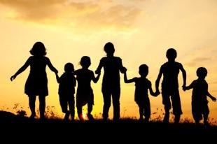 Children running on meadow at sunset SBI 300996173